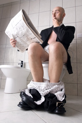 Reading newspaper on toilet